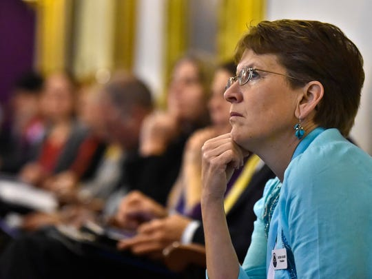 Laura Soares of the Vermont School Boards Association, listens to testimony during a joint meeting of the House and Senate health committees at the Statehouse on Thursday, January 13, 2015.