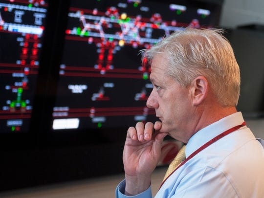 DRPA CEO John Hanson overlooks the overview board in the PATCO Center Tower in Camden.  05.30.14