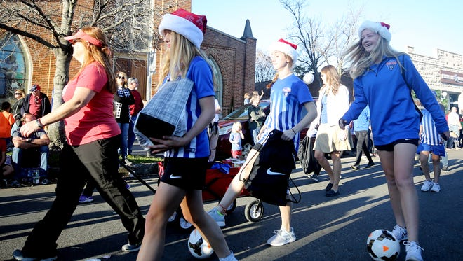 Members of the Tennessee Soccer Club participate in The Franklin Kiwanis Christmas Parade held Saturday December 2, 2017.