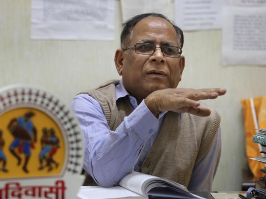 """Anthropology professor at Delhi University P.C. Joshi speaks to the Associated Press in his office in New Delhi, India, Thursday, Nov. 22, 2018. The Indian island where a young American was killed last week has been cut off from the world for thousands of years, with islanders enforcing their own isolation. While scholars believe North Sentinelese islanders probably migrated from Africa roughly 50,000 years ago, almost nothing is known about their lives today, from what language they speak to how many survive. """"We have become a very dangerous people,"""" Joshi said, """"even minor influences can kill them."""""""