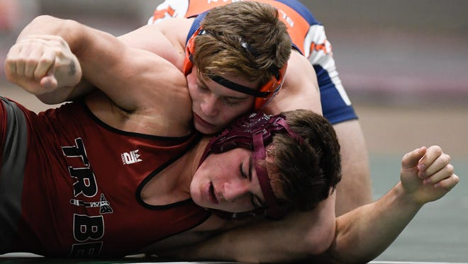Blackman's Spencer Layne tries to pin Dobyns Bennett's Jett Harris during the TSSAA Wrestling Dual State Championships at Williamson Co. AgExpo Friday, Feb. 2, 2018 in Franklin, Tenn.