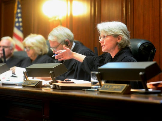 Associate Justice Beth Robinson, right, asks a question during a public records case discussion at the Vermont Supreme Court on June 7, 2017.