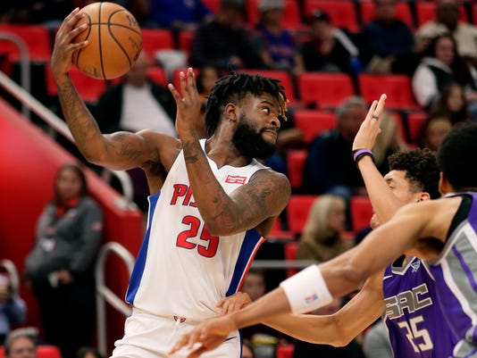 Detroit Pistons forward Reggie Bullock (25) passes the ball against the Sacramento Kings during the first half of an NBA basketball game Saturday, Nov. 4, 2017, in Detroit. (AP Photo/Duane Burleson)