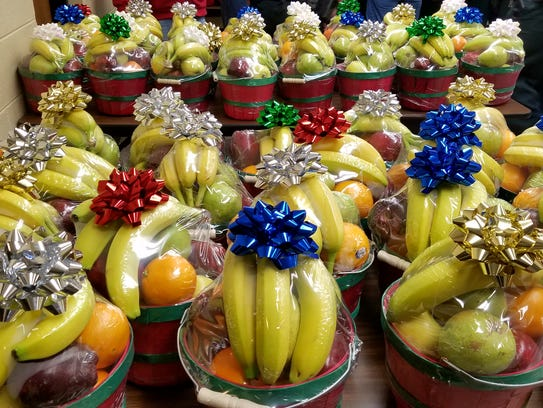 Antioch Baptist Church members deliver 127 fruit baskets
