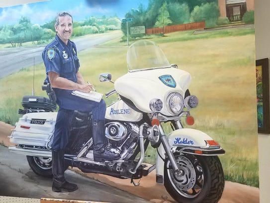 A painting of officer Rodney Holder by Abilene artist Kina Tiemann. Holder died in a motorcycle accident April 29, 2010, after serving the department for almost three decades.