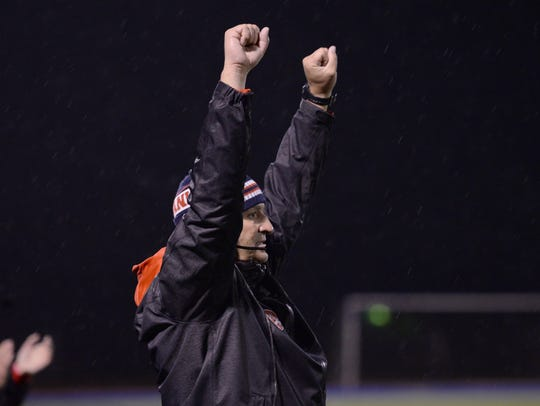 Franklin head coach Chris Kelbert celebrates Franklin's