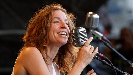 "FILE - In this May 6, 2012 file photo, Ani DiFranco performs with the Preservation Hall Jazz Band at the New Orleans Jazz and Heritage Festival in New Orleans.  The million-selling musician and longtime activist has signed with Viking for a memoir that will reflect upon her ""eventful and radical life.""  Viking told The Associated Press on Tuesday, Jan. 10, 2017,  that the book is untitled and does not yet have a release date. (AP Photo/Gerald Herbert, File)"