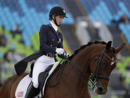 United States' Laura Graves, riding Verdades, competes in the equestrian dressage competition at the 2016 Summer Olympics in Rio de Janeiro, Brazil, in August. Graves and the U.S. Team won bronze.