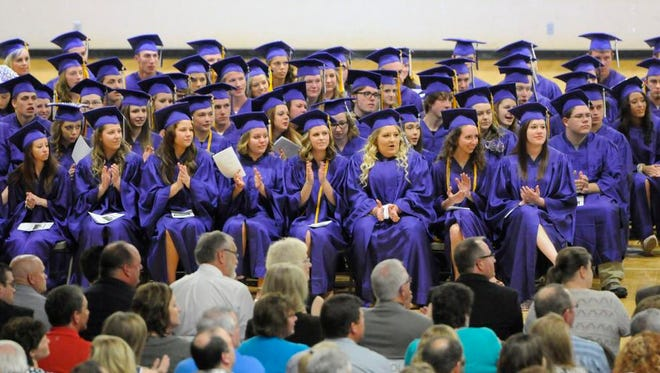 Albany students wait to receive their diplomas during Friday's graduation ceremony at Albany High School in Albany.