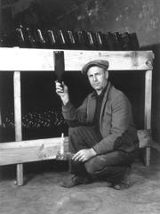 George Lonz, a wine maker at Middle Bass Island's Lonz Winery, poses for a photo with his family's world-famous wine in 1935.