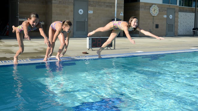 The Von Scherr girls of La Quinta train and compete in swimming. From left, Emmi, Akemi and Mikka, shown at the Palm Desert Aquatics Center.