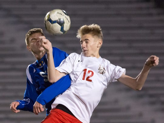 Susquehannock's Colton Mumley (No. 12) battles South Park's Dan Irwin for the ball on Tuesday in Altoona.  South Park defeated Susquehannock 4-2 in the PIAA Class AA boys' soccer semifinals