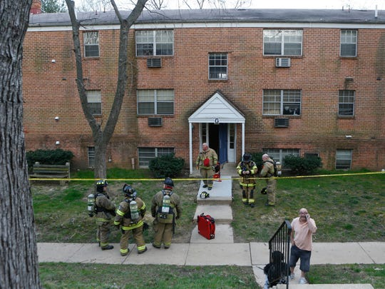 Firefighters respond to the The Evergreen Apartments at Riverfront Heights near Elsmere on Friday. The deaths of four residents are under investigation.