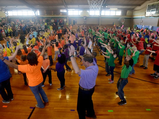 Beech Bluff Elementary School students and teachers perform a dance routine to 'Brand New Day' on Friday during their Spring Musical.