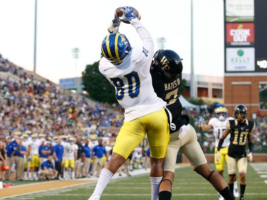 Delaware receiver Diante Cherry snags a pass for a