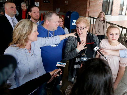 Liz Stage speaks to the media about the guilty verdict against Thomas Clayton as her daughter, Kim, reaches her hand out Feb. 23, 2017.