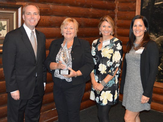 Junior Achievement representatives in Wausau accept
