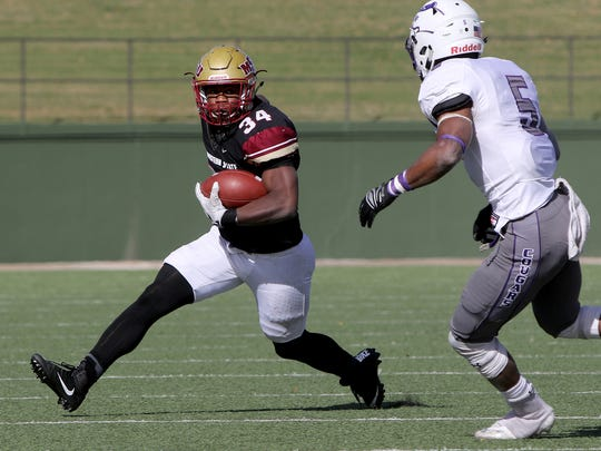 Midwestern State's Vincent Johnson changes direction of try to go around Sioux Falls' Josh Butler Saturday, Nov. 18, 2017, at Memorial Stadium. The Mustangs defeated the Cougars 24-20 in the first round of the NCAA DII Playoffs.