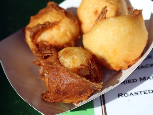 "Mashed Potato Balls <b>Location: </b>Bud's Spuds <b>Price:</b> $6 <b>Size: </b>Four deep-fried potato balls about four inches wide <b>Mess factor: </b>Two napkins <b>Artery clogging scale: </b>Did we say it was deep-fried? It's also loaded with cheese and bacon, so it's pretty high on the scale. <b>Comments from our SJ team: </b>""The cheese and bacon were a nice surprise as they are not advertised as having either."""