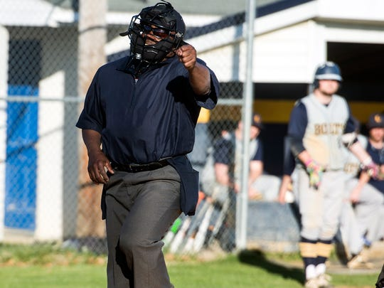 Umpire James Jenkins strikes out a Littlestown batter, Friday, April 20, 2018. The Biglerville Canners beat the Littlestown Bolts, 10-1.