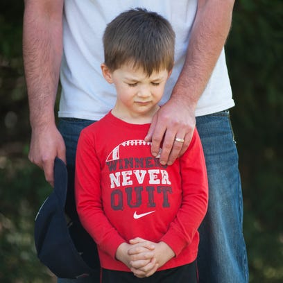 Jason Thomas of Simpsonville holds his son, Hayes,