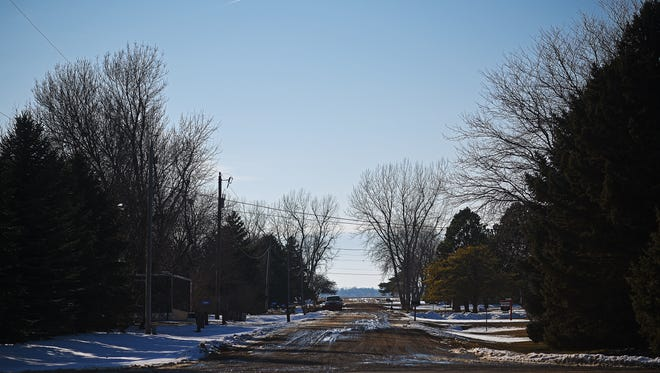 A dirt 42nd Street runs through the Prairie Meadows neighborhood Monday, Feb. 27, 2017, in Sioux Falls. Sewer prices for the neighborhood, which technically isn't in Sioux Falls city limits, are going from $100 to $235 a month.