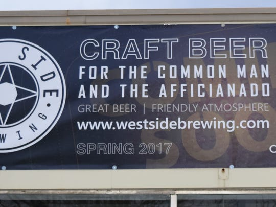 A sign on the soon-to-open West Side Brewing.