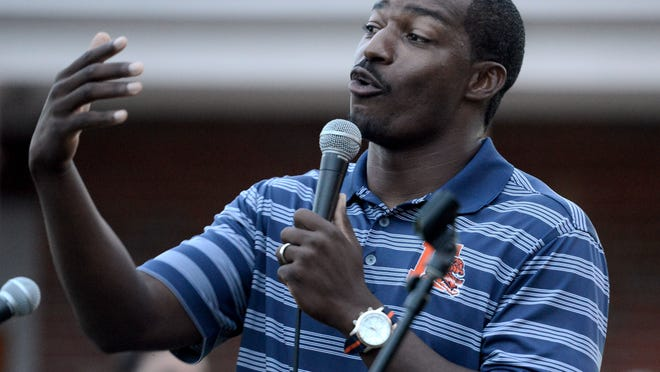 Escambia High School head coach Willie Spears speaks to hundreds of supporters during a rally at Myrtle Grove Methodist Church.