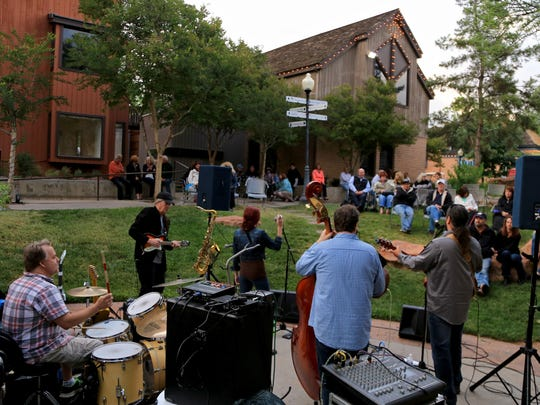Gordon Strang, left, performs with Bean and Wheels during the Ancestor Square Spring Concert Series in St. George.