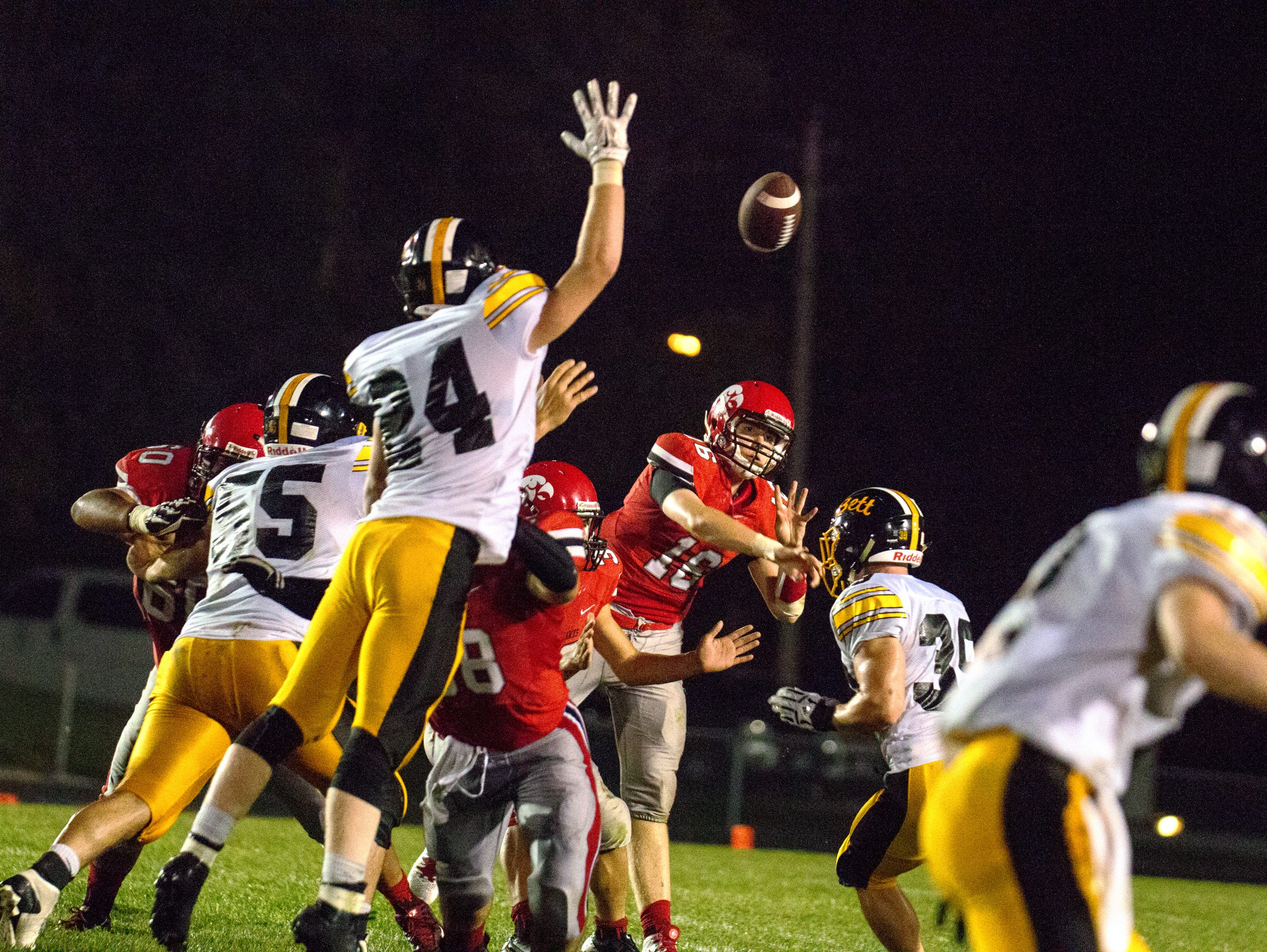 Iowa City High's Jarod Taylor (16) launches a pass against Bettendorf at Bates Field in Iowa City on Friday, September 4, 2015.