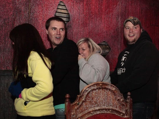 Groups react to actors at Scarevania haunted attraction in this file photo.