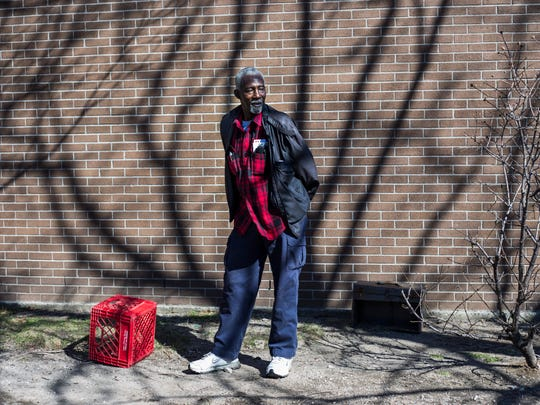 Raymond Chapman, 80, of Detroit, outside of his apartment building in the Forest Park neighborhood in Detroit on Friday, February 23, 2017.