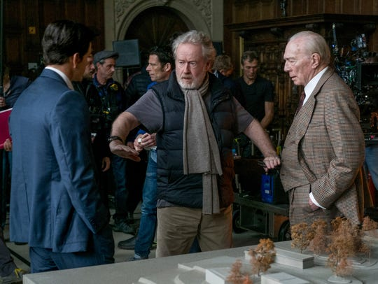 Mark Wahlberg, left, and Christopher Plummer, right,