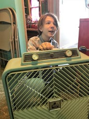 Reece Umbreit of North Fond du Lac shows off one of the vintage box fans contained in his collection of more than 400 fans.