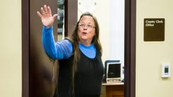 Rowan County Clerk Kim Davis, right, returns to her