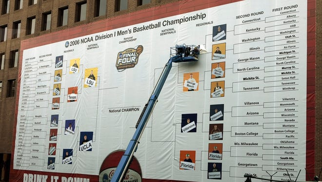 Construction workers fill out the Final Four bracket on the side of the Hyatt Regency building in 2006 in Indianapolis.
