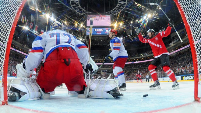 Sean Couturier (R) of Canada celebrates as teammate Tyler Ennis (not seen) of Canada scores their team's second goal during the 2015 IIHF Ice Hockey World Championship gold medal Game between Canada and Russia at the O2 Arena.