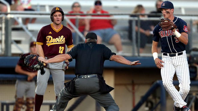Arizona State leadoff hitter Gage Canning (12) left, and Arizona third baseman Bobby Dalbec (3) watch the home plate ump signal Canning safe on his triple to open their their Pac-12 showdown at Hi Corbett Field, Friday, May 11, 2016, Tucson, Ariz.