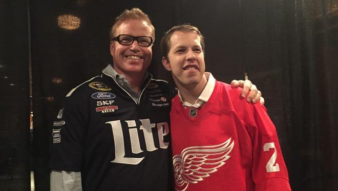 Former Red Wings defenseman and NASCAR driver Brad Keselowski pose for a photo Tuesday at Joe Louis Arena.