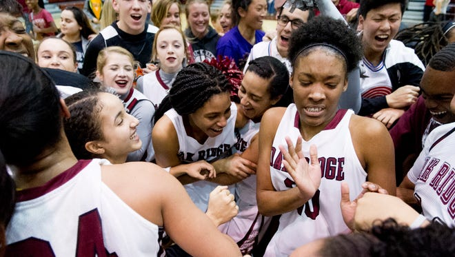 The Oak Ridge girls basketball team celebrates after defeating Daniel Boone 61-44 during the Class AAA sectionals at Oak Ridge High School on Saturday.
