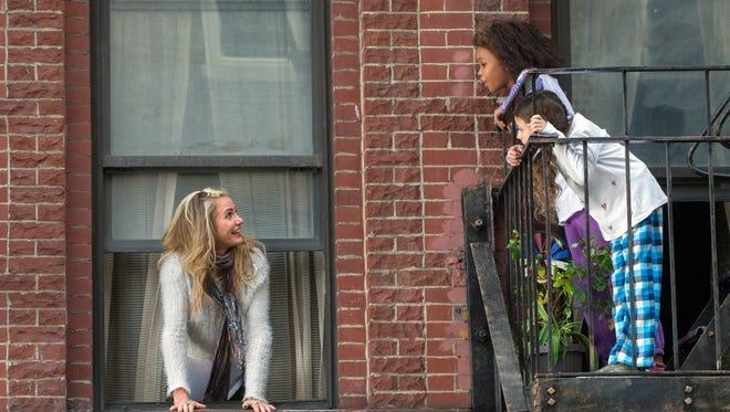 """Cameron Diaz as Hannigan and Quvenzhane Wallis as Annie in """"Annie."""""""