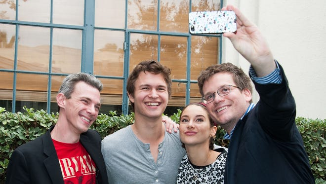 """On Nov. 20, """"The Fault in Our Stars"""" director Josh Boone, left, actors Ansel Elgort and Shailene Woodley and author John Green attended the dedication of an honorary """"TFIOS"""" bench in Los Angeles."""