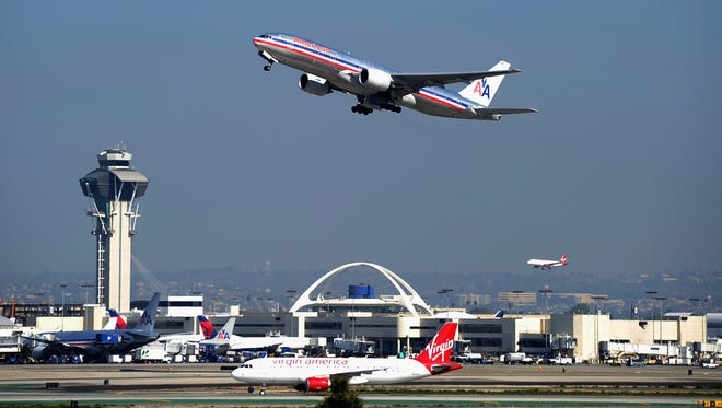 An American Airlines plane takes off from Los Angeles International Airport on Feb. 1, 2012.