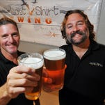 Johann Brockhausen President/Brew Master and friend Mark Reed Vice-President /Brew Master both of Melbourne toast some Point Break Ale to the Lost Shirt Brewing Company in West Melbourne they hope to open early September.