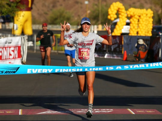 Anna Long wins the women's division during the 14th
