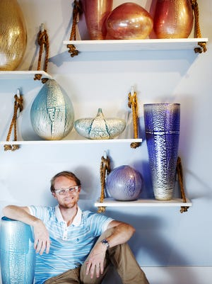 Naples based glass artist, Conrad Williams with some of his pieces.