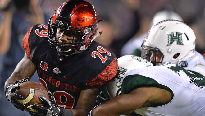 SDSU running back Juwan Washington runs for a touchdown in a win over Hawaii.
