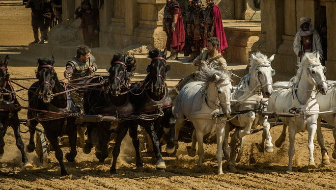 """Messala (left, Toby Kebbell) races adopted brother Judah Ben-Hur (Jack Huston) with life and honor at stake in """"Ben-Hur."""""""