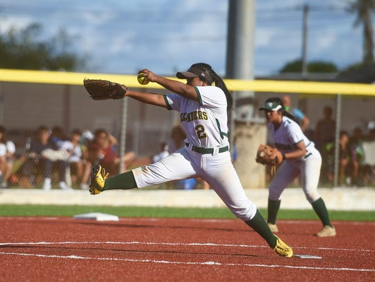In this March 10, 2018, file photo, John F. Kennedy Islanders pitcher Pillar George fires from the mound in the girls softball championship game.