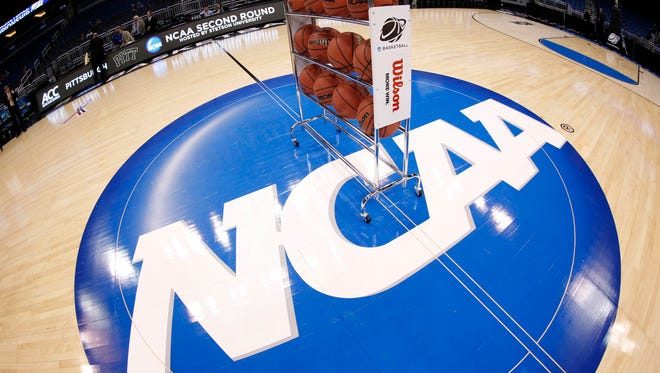 The NCAA distributed $547.1 million to Division I schools and conferences in its 2014 fiscal year.